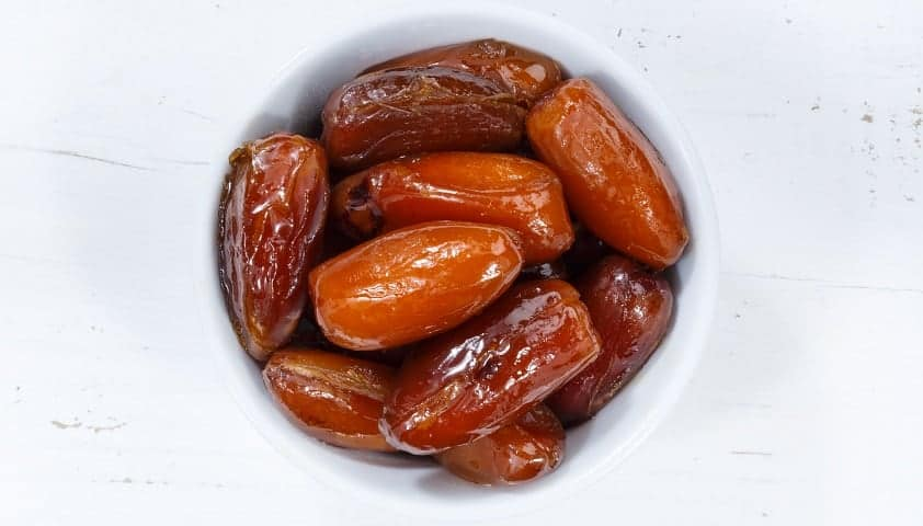 Dates fruit date from above bowl wooden board