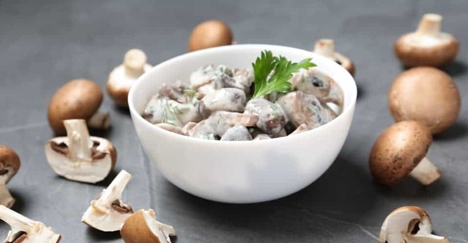 bowl of fried mushrooms with sauce