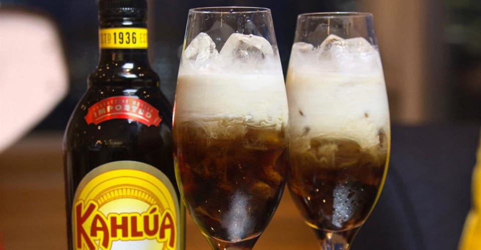 one bottle and two glasses of kahlua