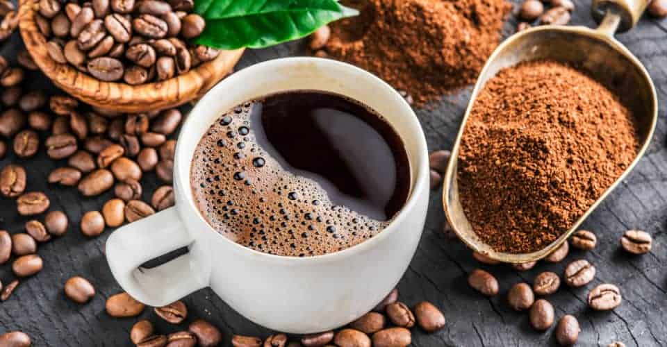 roasted coffee beans ground coffee and cup of coffee