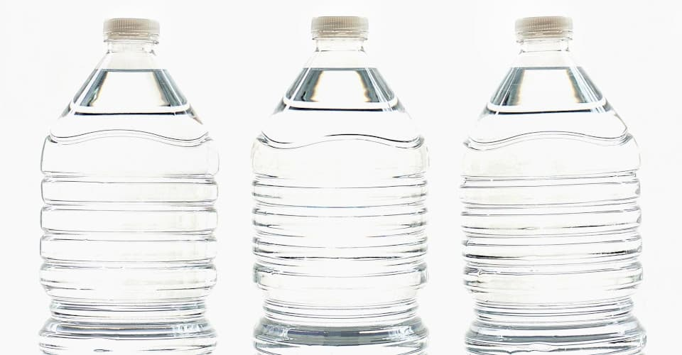three bottles of drinking water