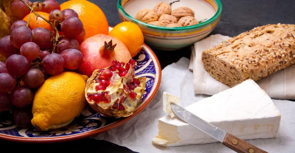brie cheese with bread and fruit