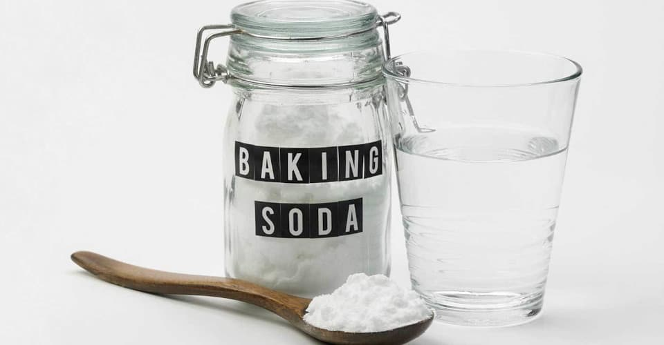 jar of baking soda and glass of water