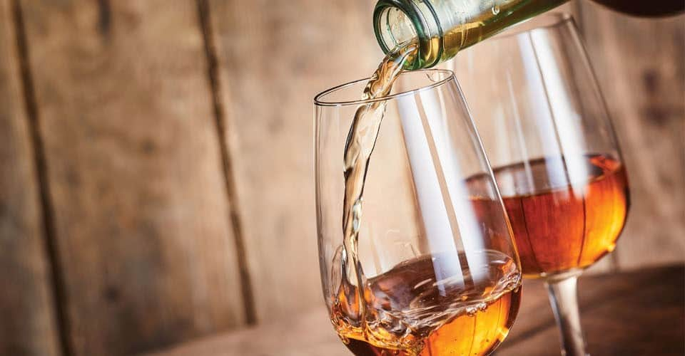 pouring sherry into glass