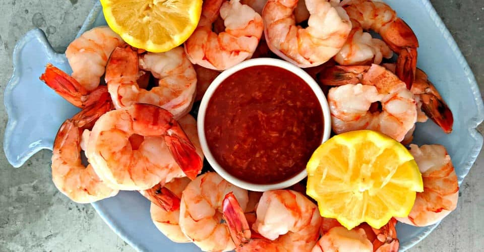 cocktail sauce in bowl and shrimp