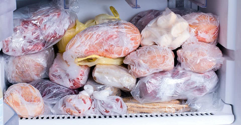 some wrapped food in freezer